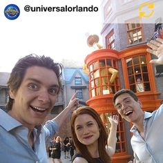 The Phelps twins and Bonnie Wright in front of the Weasleys' Wizard Wheezes