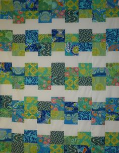 Our beginning quilting class.  Cloud 9 quilt by Villa Rosa Designs, Amy Butler fabrics in sample