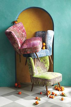 Anthropologie EU Moresque Chair. More than just an accent, this handcarved respite sets the tone for the entire room with a modern, armless shape and kaleidoscopic colours. Its luxe velvet upholstery is inspired by traditional Turkish rugs, which our buyer re-imagined in washed velvet.