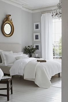 Contemporary Master Bedroom with Chandelier, Standard height, West elm - mod upholstered bed, Paint, Crown molding