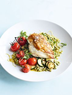 This wonderful crispy-skinned lemon chicken with pearl couscous, roasted tomatoes and zucchini is so easy to make and intensely delicious! Crispy Chicken Salads, Chicken Recipes, Roast Chicken Zucchini, Chicken Couscous, Zucchini Slice, Clean Recipes, Cooking Recipes, Healthy Recipes, Fast Recipes