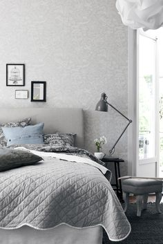 Wallpapers by  Scandinavian designers - grey headboard and picture grouping