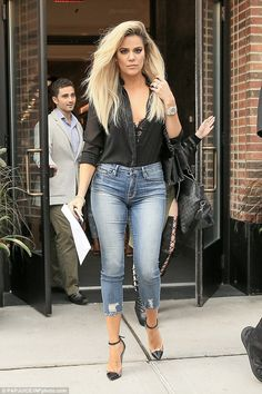 What is on your finger? Khloe Kardashian was already flashing a diamond band on her wedding finger when she stepped out in New York City on Tuesday morning