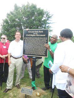 Baltimore County Executive Kevin Kamenetz unveils historic marker at Gwyn Oak amusement park site.
