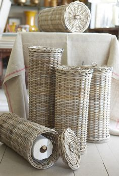 Belgian rattan baskets...hide those rolls of toilet paper in style...from Privet House, Connecticut...