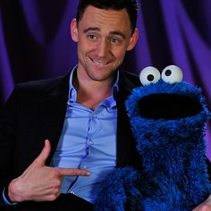 Tom Hiddleston and Sesame Street's Cookie Monster assemble at the PBS portion of the TV Critics Press Tour.
