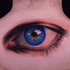 John Anderton- super realistic blue eye tattoo