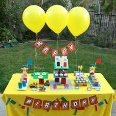 Lego INSPIRED Birthday Party. Hang banner on balloons when you don't have a backdrop. Brilliant!