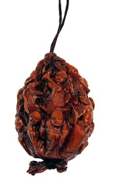 Walnut.. (or kurumi - natural walnut shell): kataborinetsuke ) style, the meat from the nut was removed by various means, one being the insertion of a small worm in a hole in the nut to consume the meat. Following that, elaborate designs were carved, and the string inserted. The carver often removed all of the nut's normal surface features and carved through the surface in places to create a latticed effect. Once carved, the resulting netsuke was polished and shellacked.