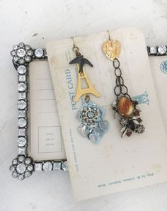 travelupcycled assembled repurposed charm earrings eifel by Arey