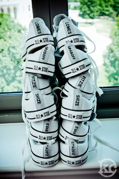 Custom made Converse with wedding date and groomsment's nicknames on the back! Brilliant!