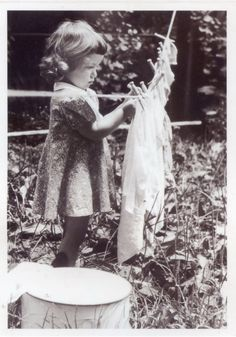 Little girl pins laundry (1944)