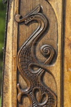 Wood carving of a dragon on a Viking boat Stock Photo