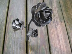 Metal rose sculpture rosebuds by MuddyRiverIronWorks on Etsy, $55.00