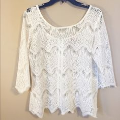 Ivory Eyelash Lace Top Gorgeous Ivory lace eyelash top. Size large. Wore only once! In wonderful condition. 3/4 length sleeves. Exposed gold zipper. My price is firm and no trades please! Eyeshadow Tops Blouses