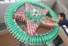 Cans and bottles into a holiday decoration! via How to Recycle