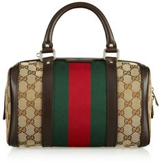 Gucci's iconic red and green web was developed in the '50s, with the monogram debuting soon after. Work the classic motif into everyday looks with this small c…