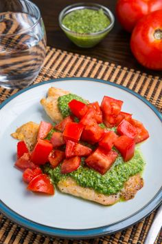 Parmesan Crusted Pesto Tilapia Bruschetta - Had this tonight for dinner....served over 2 cheese polenta (with just a bit of garlic added) and added feta and chopped basil to the tomatoes.  VERY good and dinner was ready in 15 minutes!