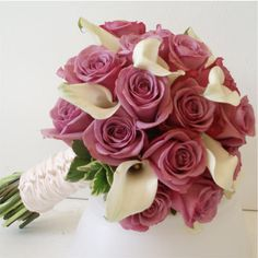 My dream bouquet but with white roses and deep red calla lillies