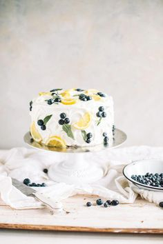 A spring lemon blueberry cake with zesty lemon buttercream! This layer cake is s. A spring lemon blueberry cake with zesty lemon buttercream! This layer cake is studded with contemporary juicy blueberries, stuffed with lemon curd an. Pretty Cakes, Beautiful Cakes, Cake Cookies, Cupcake Cakes, Fun Cakes, Cream Cookies, Yummy Cakes, Desserts Printemps, Bolo Cake