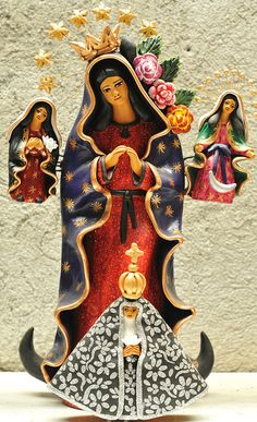 Virgen de Guadalupe, Mexico.  The silver cloaked figure in front is La Virgen de la Soledad, patroness of Oaxaca, Mexico.  This ceramic work was made by artist Concepcion Aguilar of Ocotlan, Oaxaca, Mexico. ~ photo by Teyacapan via flickr