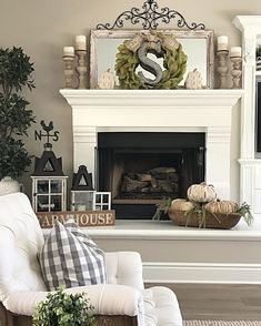 I finally added a little fall decor to my fireplace mantle and hearth. I finally added a little fall decor to my fireplace mantle and hearth. We are relaxing with the family today. I hope you're all enjoying your Sunday too! Fall Living Room, Living Room Decor, Farmhouse Fireplace, Farmhouse Decor, Farmhouse Ideas, Modern Farmhouse, Fall Mantel Decorations, Fall Decor, Mantles Decor