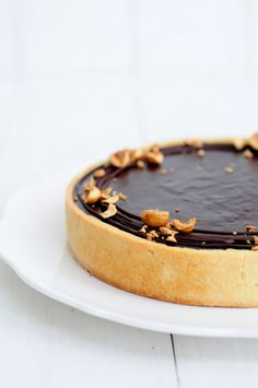 caramel chocolate tart with hazelnuts.