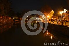 Sile river in Treviso city by night, Veneto, historical buildings on both sides, Europe.