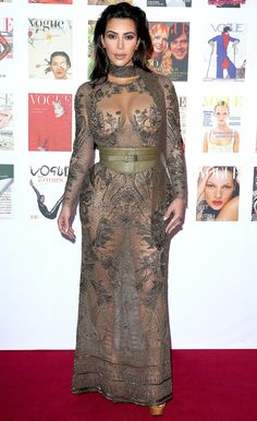 Kim Kardashian in an olive green sheer Roberto Cavalli dress