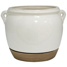 Durable and stylish, the 9 In. cream white ceramic Olivette planter comes with an attached saucer. The Olivette planter features a versatile design in a soft cream white to fit any room in your home.