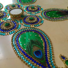 Peacock design Kundan rangoli by Suave Collection