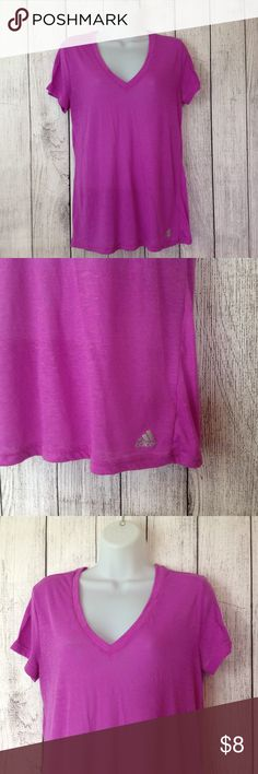 """Adidas Tee Maker: Adidas ♥ Material: Cotton Blend ♥ Color: Purple ♥ Measured Size: Pit to pit- 20"""" Pit to cuff- n.a Shoulder to waist- 26""""  ♥ Tag Size:  M ♥ Actual Size: M PLEASE CHECK YOUR ACTUAL MEASUREMENTS TO MAKE SURE IT IS THE RIGHT SIZE! THANKS! ♥ Condition: Great used Condition  ♥ Item #: (office use only) D  Follow us on Instagram and facebook for coupon codes!  INSTAGRAM-thehausofvintage1984 Facebook- intergalactic haus of vintage 1984 or @hausofvintage1984 Adidas Tops Tees - Short…"""