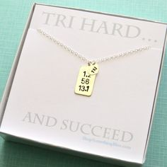 Hand Stamped Triathlon Necklace Dog Tag in Sterling silver by ShopSomethingBlue, $48.50