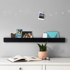 No nails required! Easy to hang with 3M strips, this No Nails Photo Rail is perfect for displaying all of your photos, inspirational quotes and memories. Hang it by your bed or above your desk to keep your favorite images close by.  Pottery Barn Dorm No Nails Photo Rail