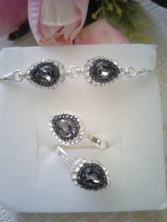 Silver bracelet and ring with silver night drop Swarovski crystals in Ceralun construction.