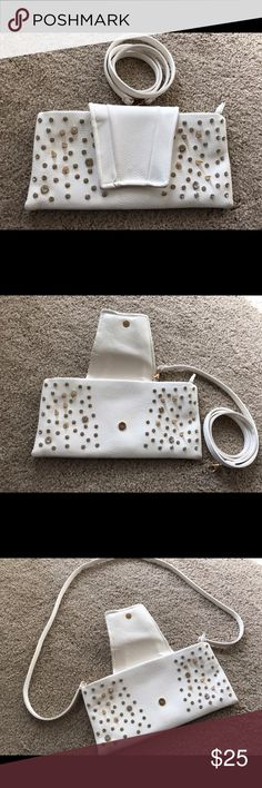 Genuine leather clutch/crossbag This is a beautiful white Genuine leather bag from Italy. I've had it for a year and no stone ever fell, it's such great quality. The spikes in random places make it look so chic and gorgeous! It can be used as a clutch or attach the strap and use as a cross body bag. The outside is in great condition, the inside looks a little worn. Bags Crossbody Bags