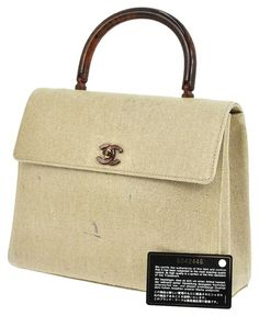 f18e5b1042f6 Save big on the Chanel Medium Kelly Vintage Beige Canvas Wood Handle Handbag  Satchel! This satchel is a top 10 member favorite on Tradesy.