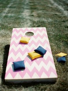 Once everyone's centers of gravity are adequately fucked, break out the cornhole boards. | 26 Ideas For Throwing The Boozy Tea Party Of Your Wildest Dreams