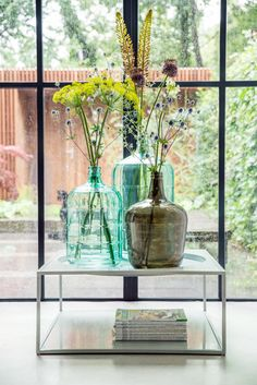 Beautiful vases, huge windows, and lots of natural light and green