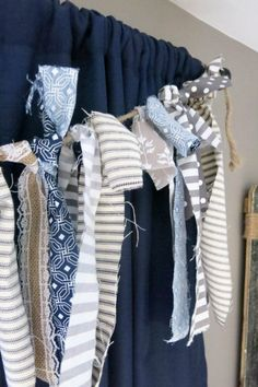 Fabric strip banner hanging in front of window in Baby Boy Nursery | Rustic Woodland Navy and Tan Baby Room | Baby Boy Rustic Woodland Nursery Inspiration | The Johnsons Plus Dog