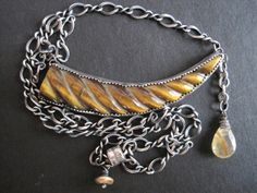 Sterling silver and carved tiger eye with rutilated by SLOANE99, $48.00