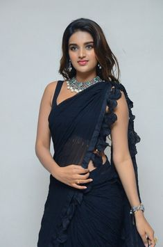 Nidhhi Agerwal in black saree photos at Ismart Shankar movie Pre-Release Event. South Indian Actress Nidhhi Agerwal in hot black saree photos. Beautiful Girl Photo, Beautiful Girl Indian, Most Beautiful Indian Actress, Beautiful Saree, Beautiful Women, Blouse Back Neck Designs, Sari Blouse Designs, Indian Bollywood Actress, Bollywood Girls