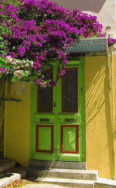 lime door, lemon walls, and trellised  bouganvilla