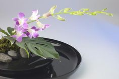 I just found out about this floral arrangement called an Ikebana. It's Japanese in origin and concentrates on beauty in balance. It is simple, elegant, below eye level,and doesn't require alot of flowers to create. If each table at a reception had a similar yet different ikebana design it would be representative of individual style