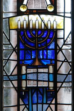 """Barbara's Church, Earlsdon detail from central lancet depicting candles of the Jewish """"Hanukkah menorah"""" below the Torah scrolls by stained glass artist Derek Hunt FMGP Modern Stained Glass, Stained Glass Designs, Stained Glass Projects, Stained Glass Patterns, Stained Glass Art, Stained Glass Windows, Coventry Cathedral, Church Windows, Jewish Hanukkah"""