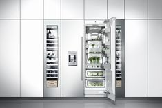 Gaggenau - here is what we are thinking - so wine fridge, freezer, and fridge; see the panneling above to square off the wall ... we could do cupboards above to match the drawers perhaps