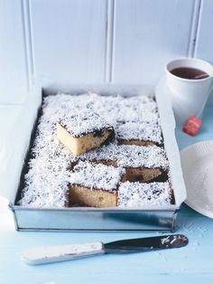 lamington slice   125g unsalted butter, softened   ¾ cup caster (superfine) sugar   1 teaspoon vanilla extract   2 eggs   1¼ cups plain (all-purpose) flour, sifted   1¼ teaspoons baking powder, sifted   ½ cup (125ml) milk   1 cup (75g) shredded coconut