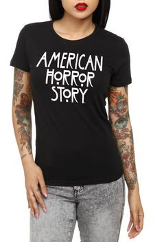This fitted black tee features a white front screen of the American Horror Story logo.