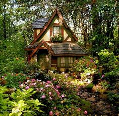 Storybook cottage surrounded by blooms