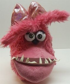 "Despicable Me Gru's Pet Dog ""Kyle"" 12"" Plush Doll Dressed Up Like a Girl, http://www.amazon.com/dp/B00CTANPJW/ref=cm_sw_r_pi_awd_Z7-lsb19EW07R"